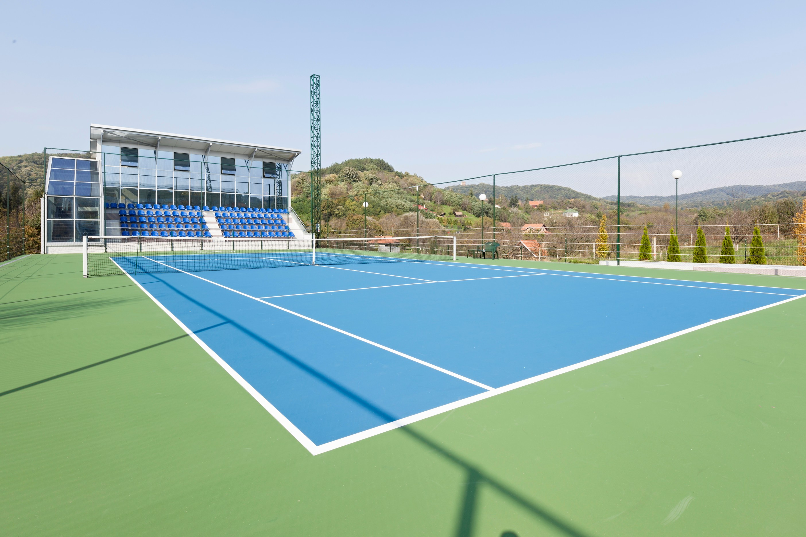 Specialists in porous and non-porous acrylic tennis court surfaces