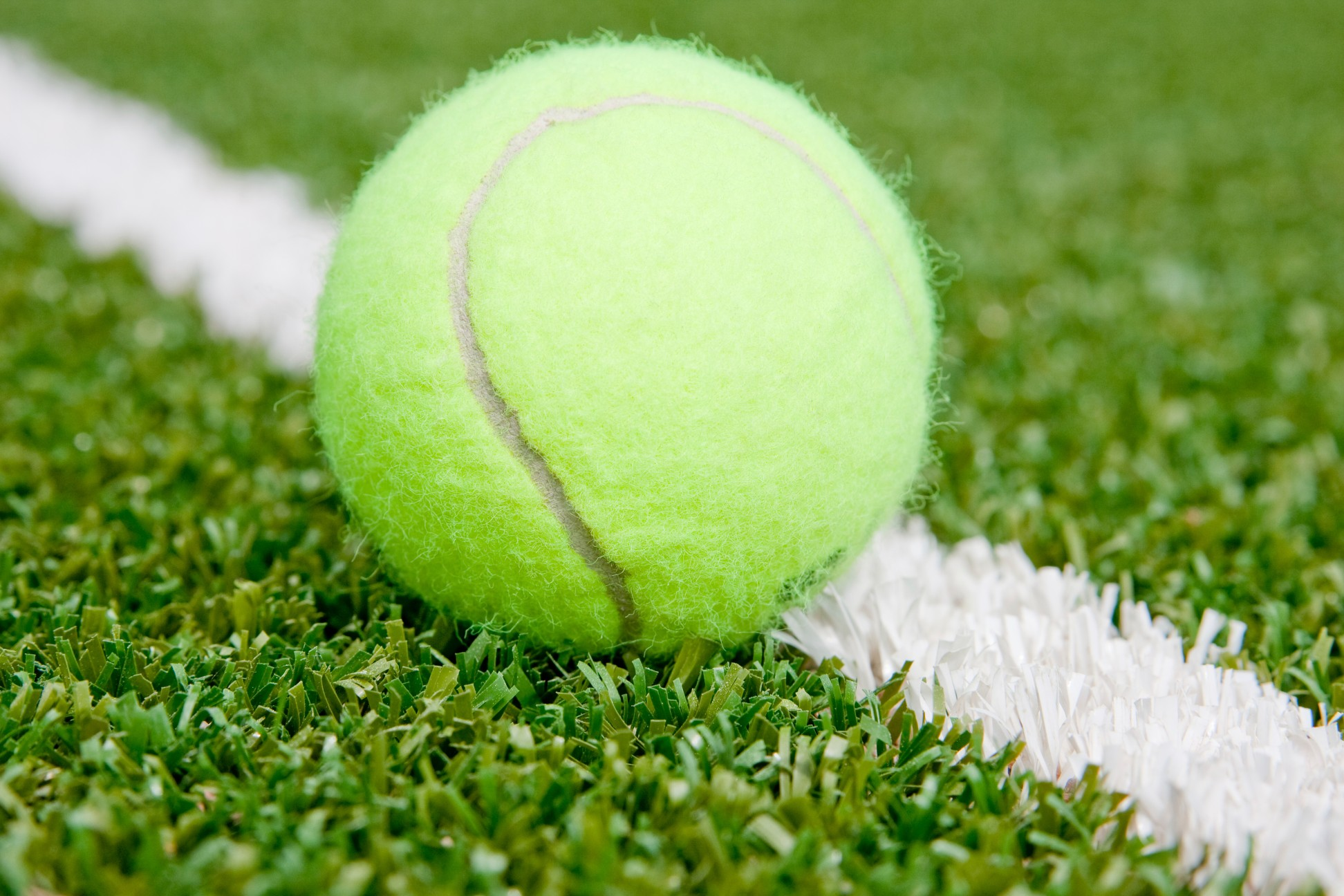 Artificial grass is the ideal high-performance finish for synthetic tennis courts.