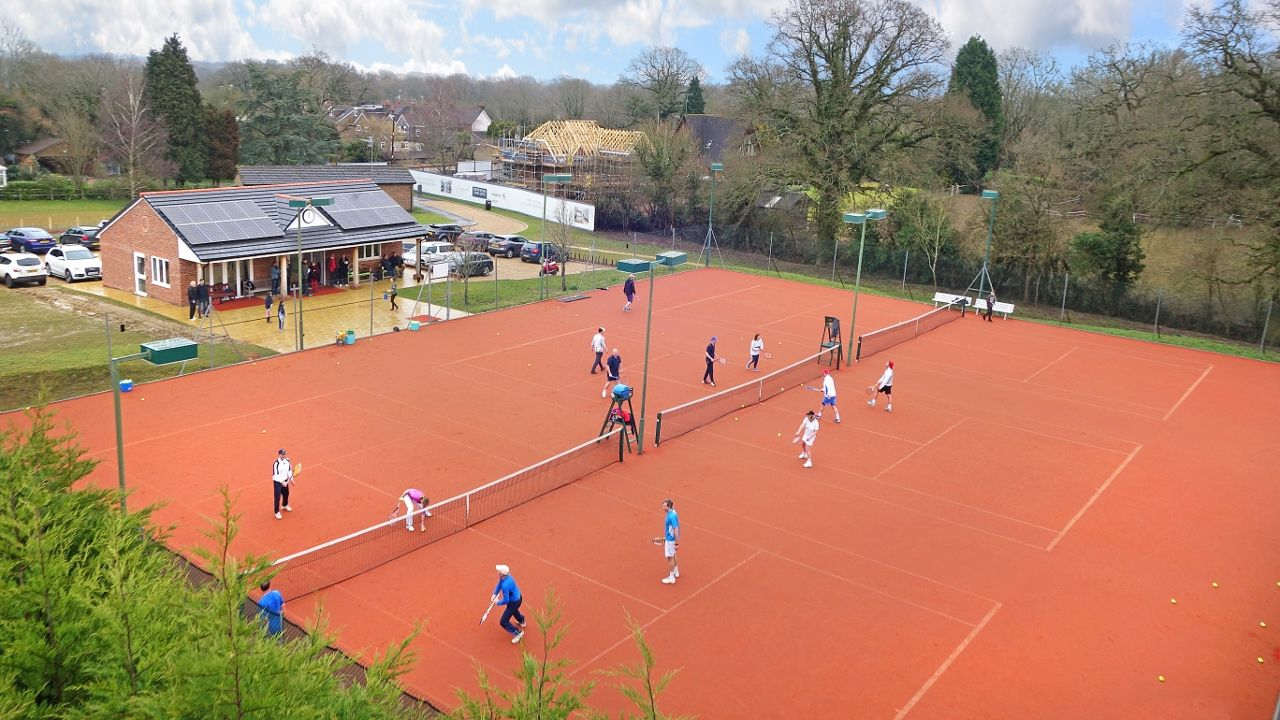 Clay tennis courts provide the ideal hardwearing surface for busy UK clubs.