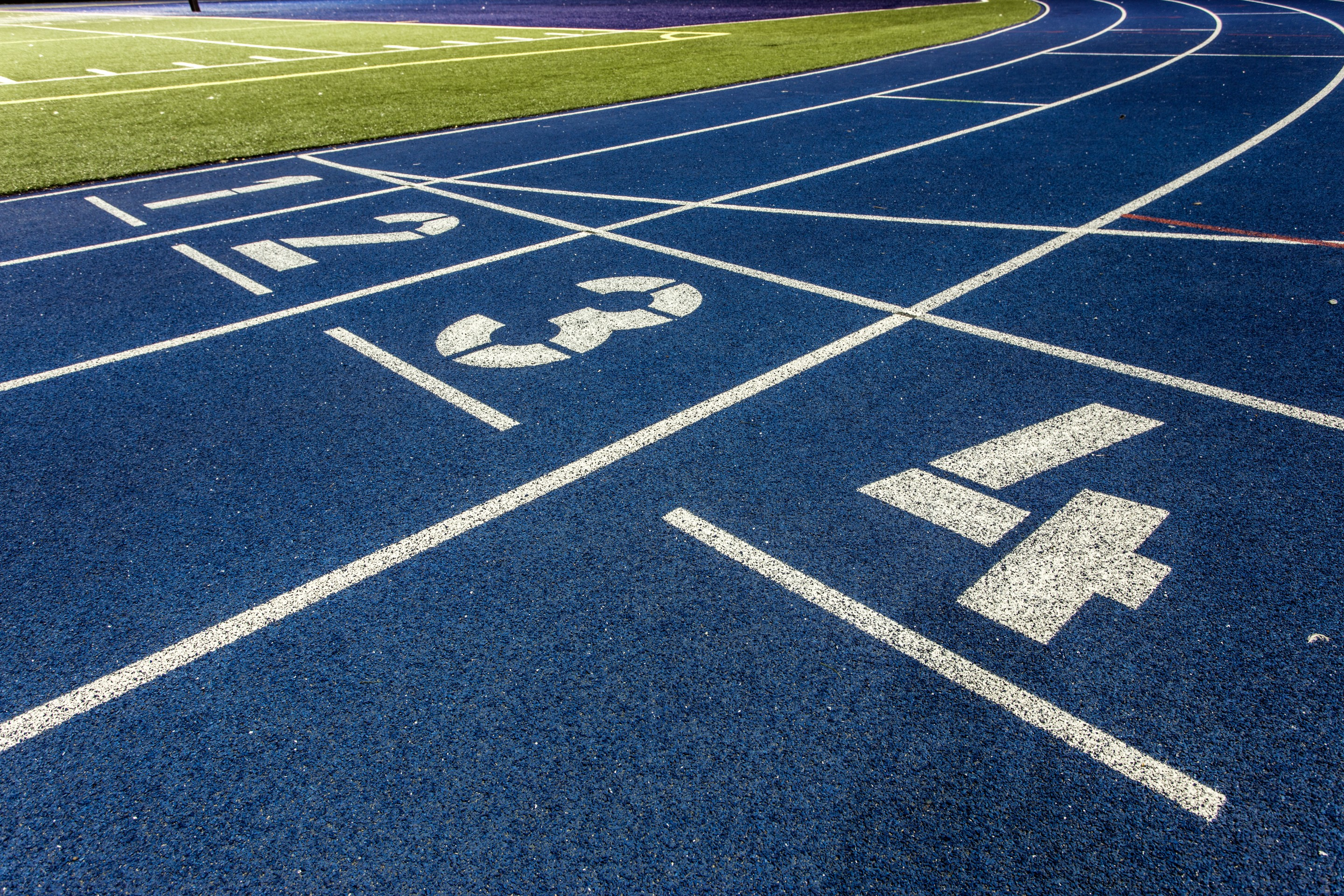 Polymeric surfaces for athletics facilities can be customised with a range of colours and markings.