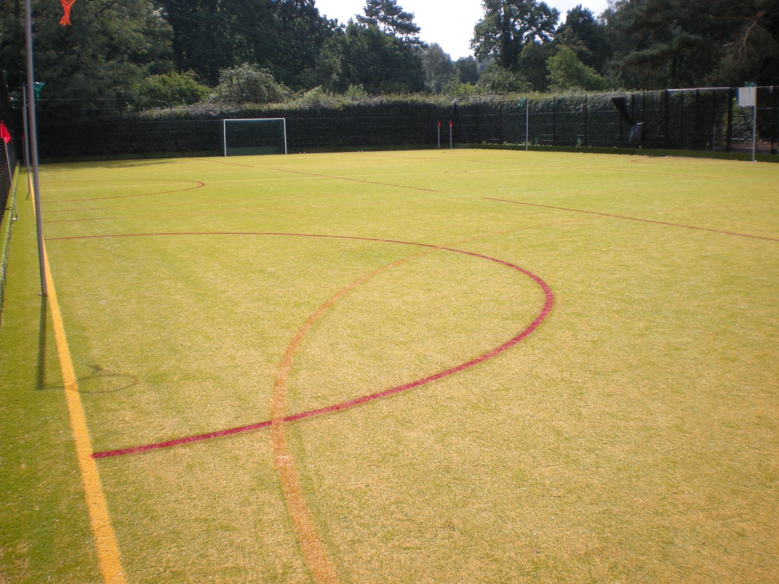 A MUGA pitch can be finished with multiple markings on the artificial grass surface.