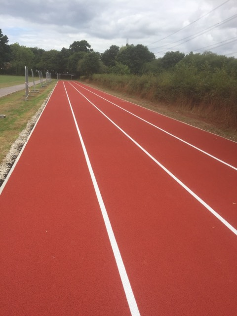 A running track installation with a polymeric surface can be customised with different sizes, colours and markings.
