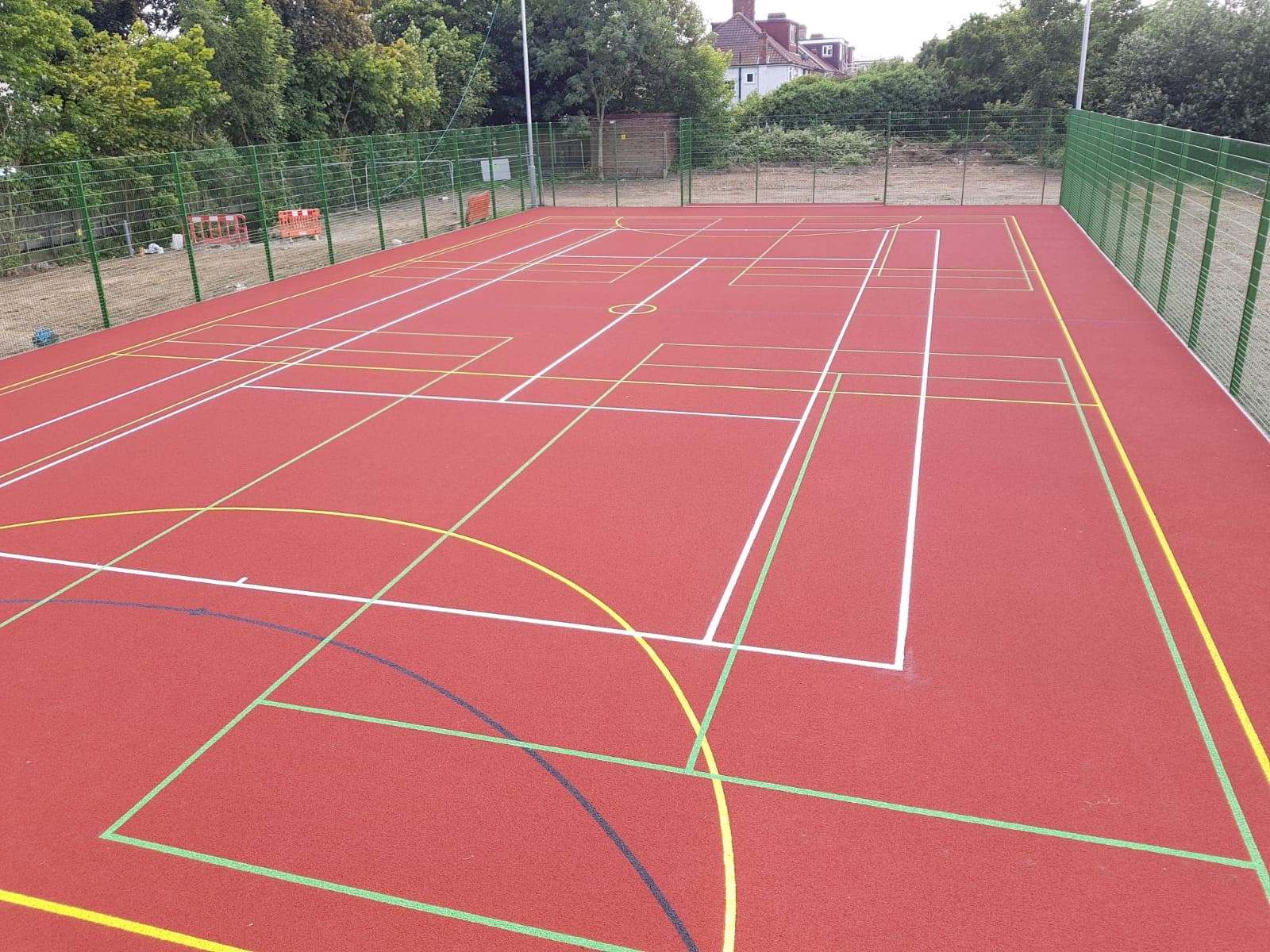A polymeric surface is the ideal safe, hardwearing solution for a MUGA pitch