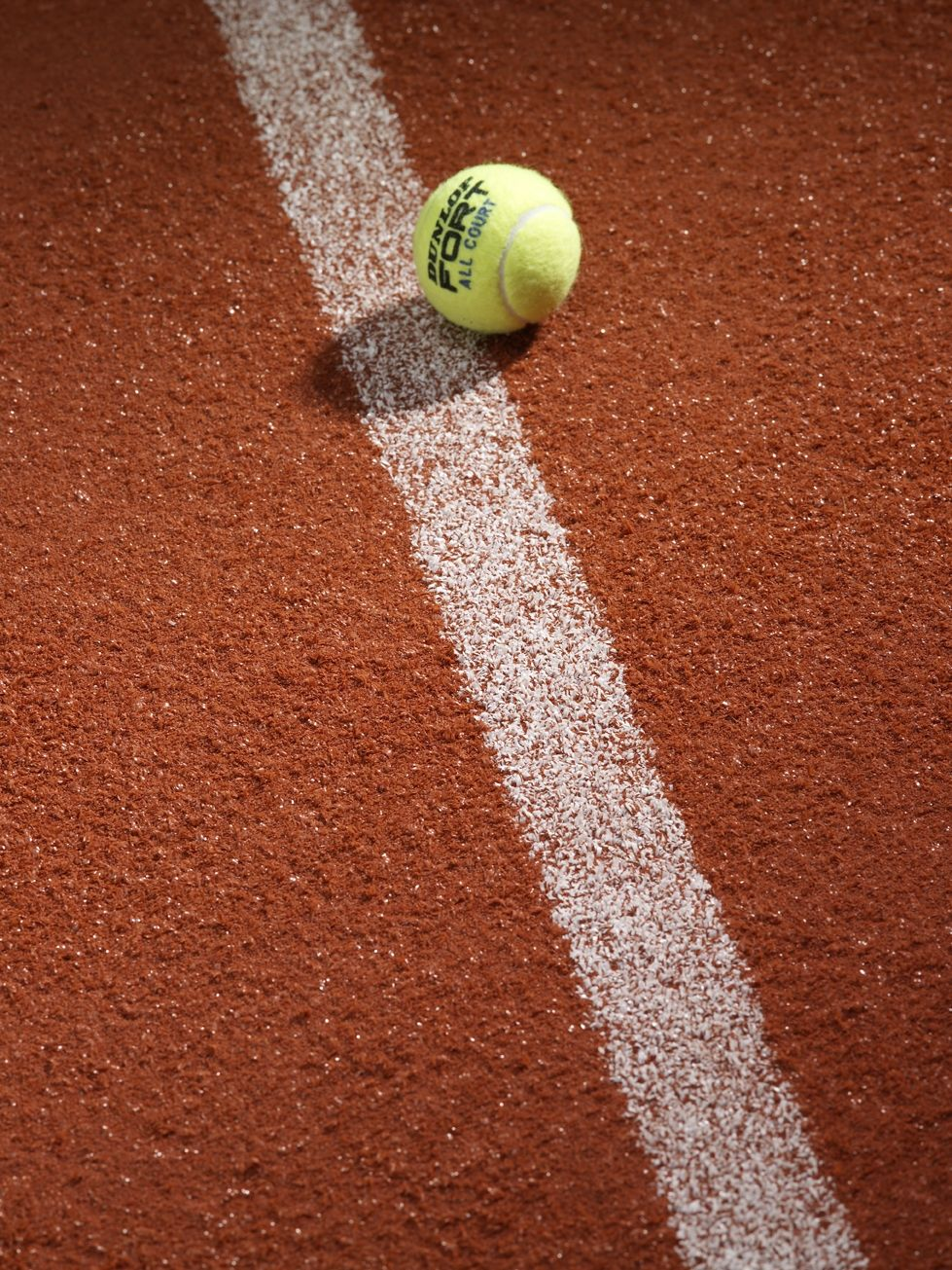 Artificial clay tennis courts can stand up to the UK's weather, come rain or shine.