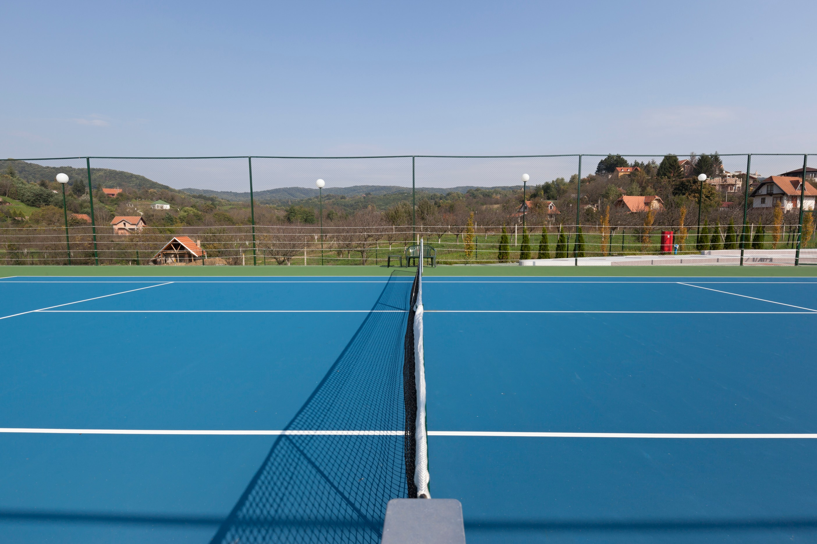 Tennis court resurfacing can be finished with a choice of colours and markings
