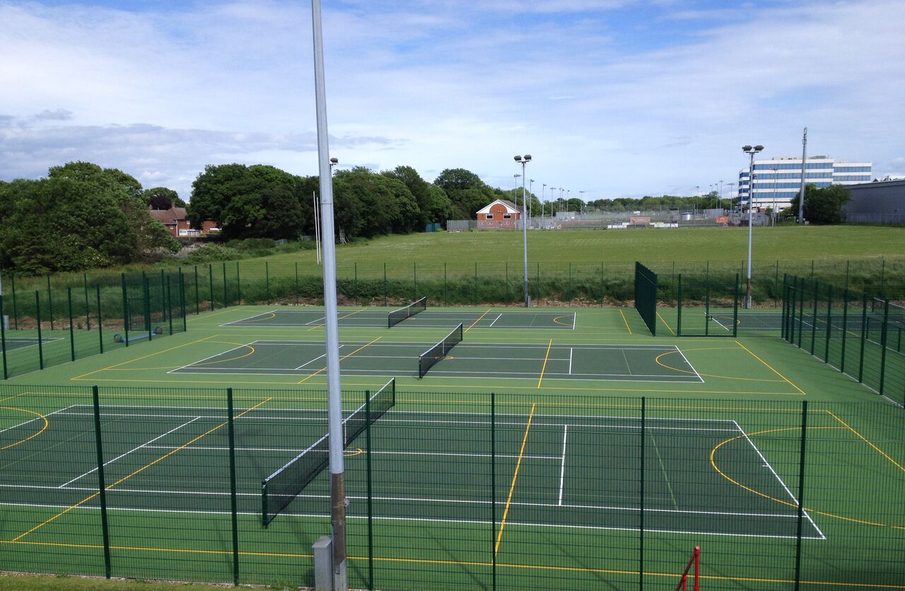Installing tennis court surfaces for all sizes of club and levels of play