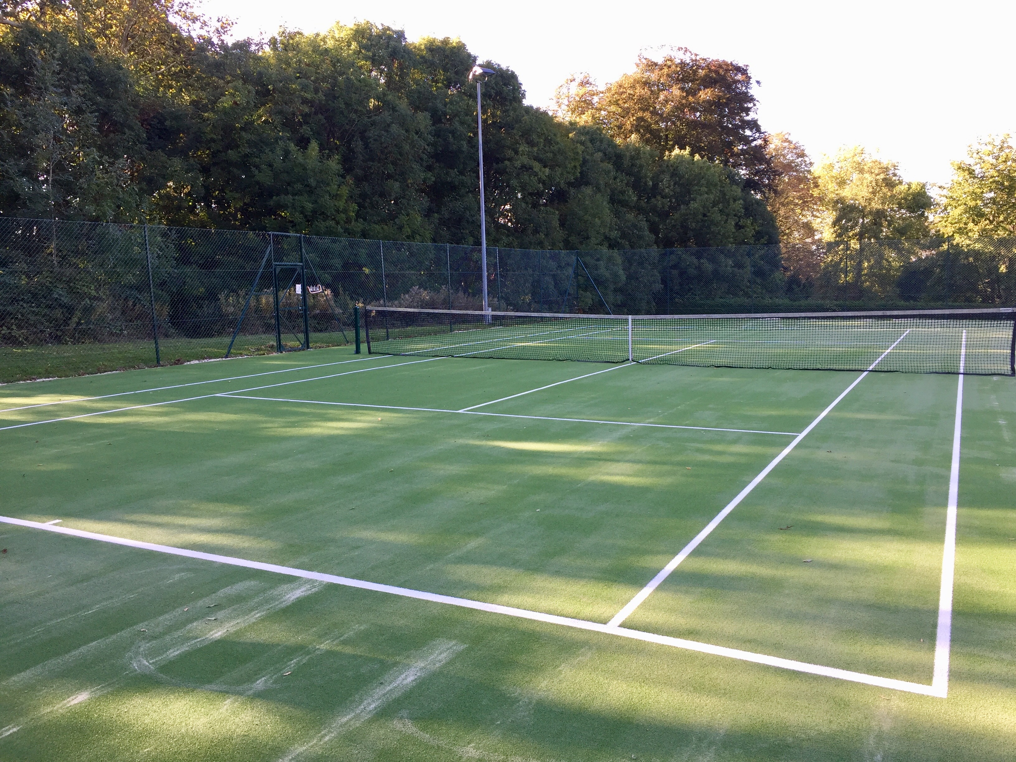 A new sand filled artificial grass surface for a leading tennis club