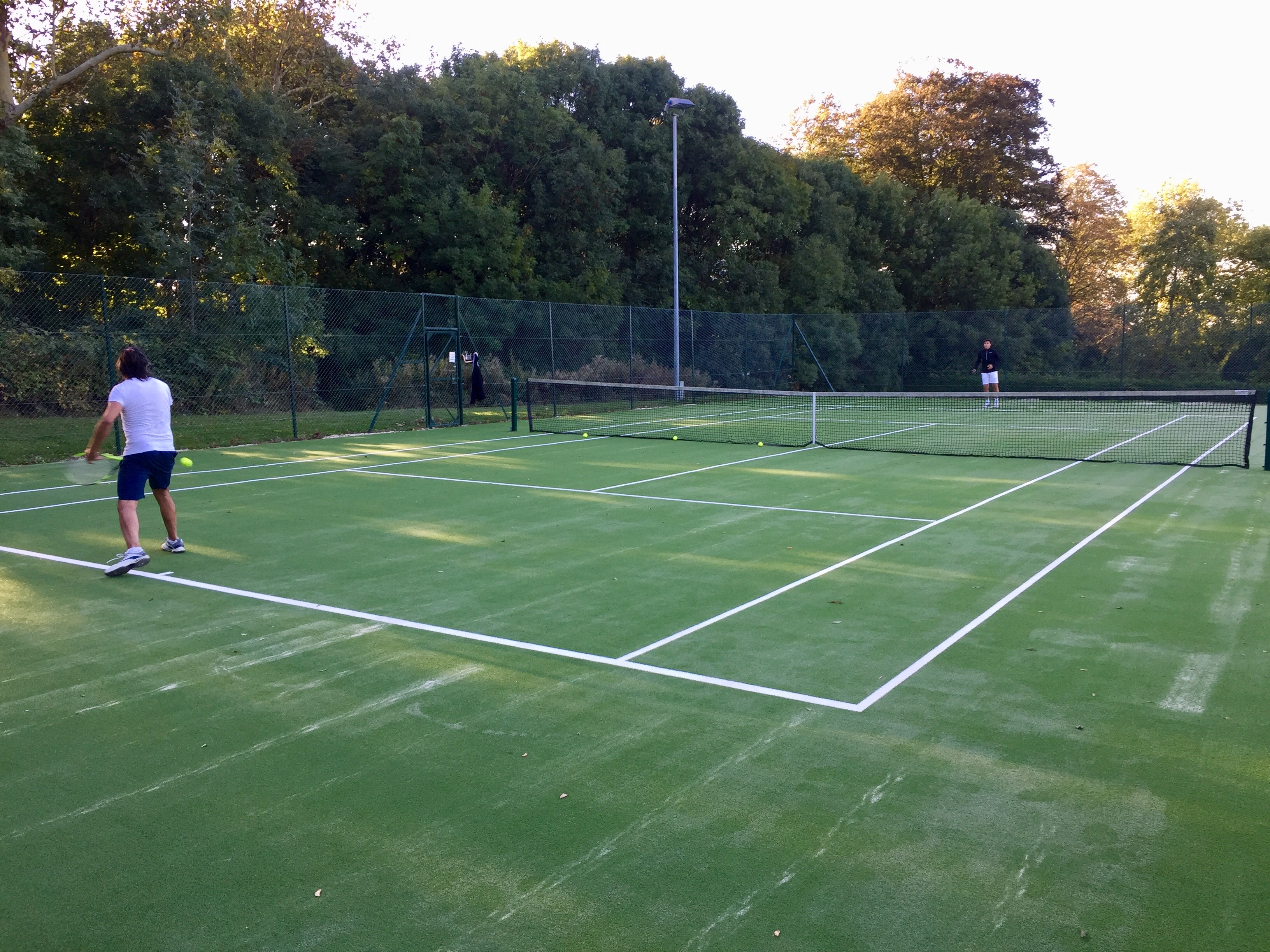 Completing Muswell Hill's new tennis court surfaces