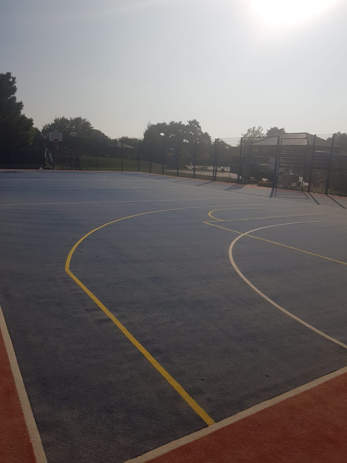This school MUGA surface is constructed from a needle punch carpet, finished with multi-sports markings