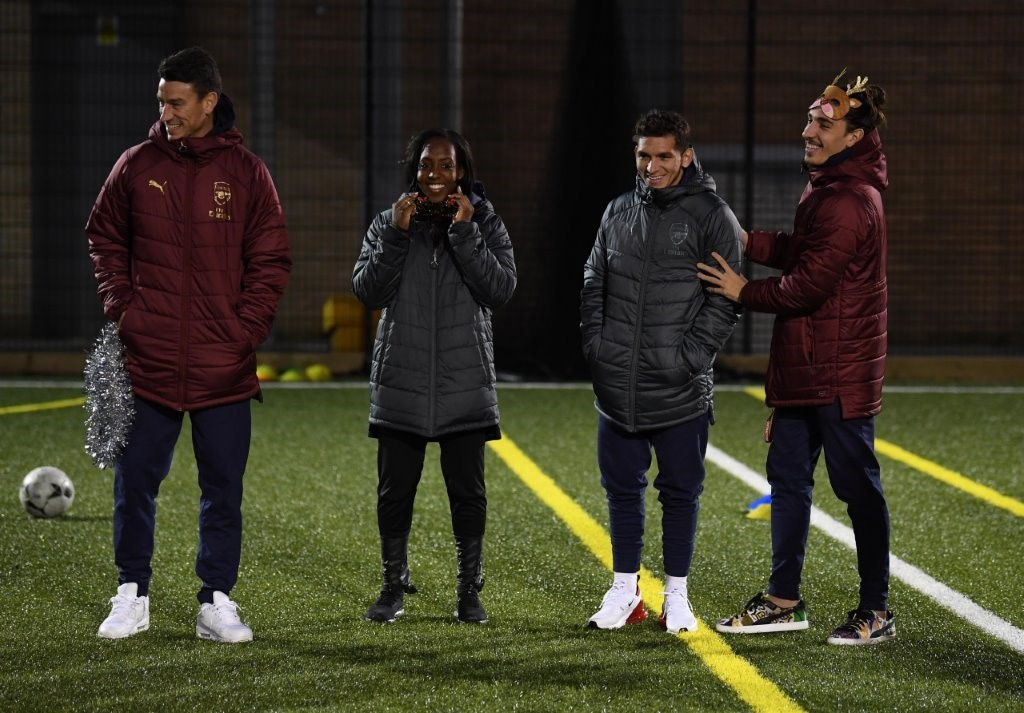 Arsenal players Laurent Koscielny, Danielle Carter, Lucas Torreira and Hector Bellerin enjoy the new 3G pitch funded by The Arsenal Foundation and installed by ETC Sports Surfaces.