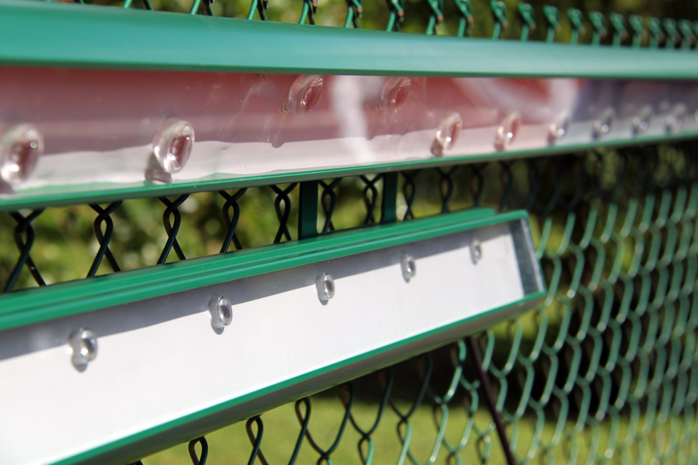 Tennis court lighting by Tweener® fully integrates into your court's fencing and is easy and economical to install.