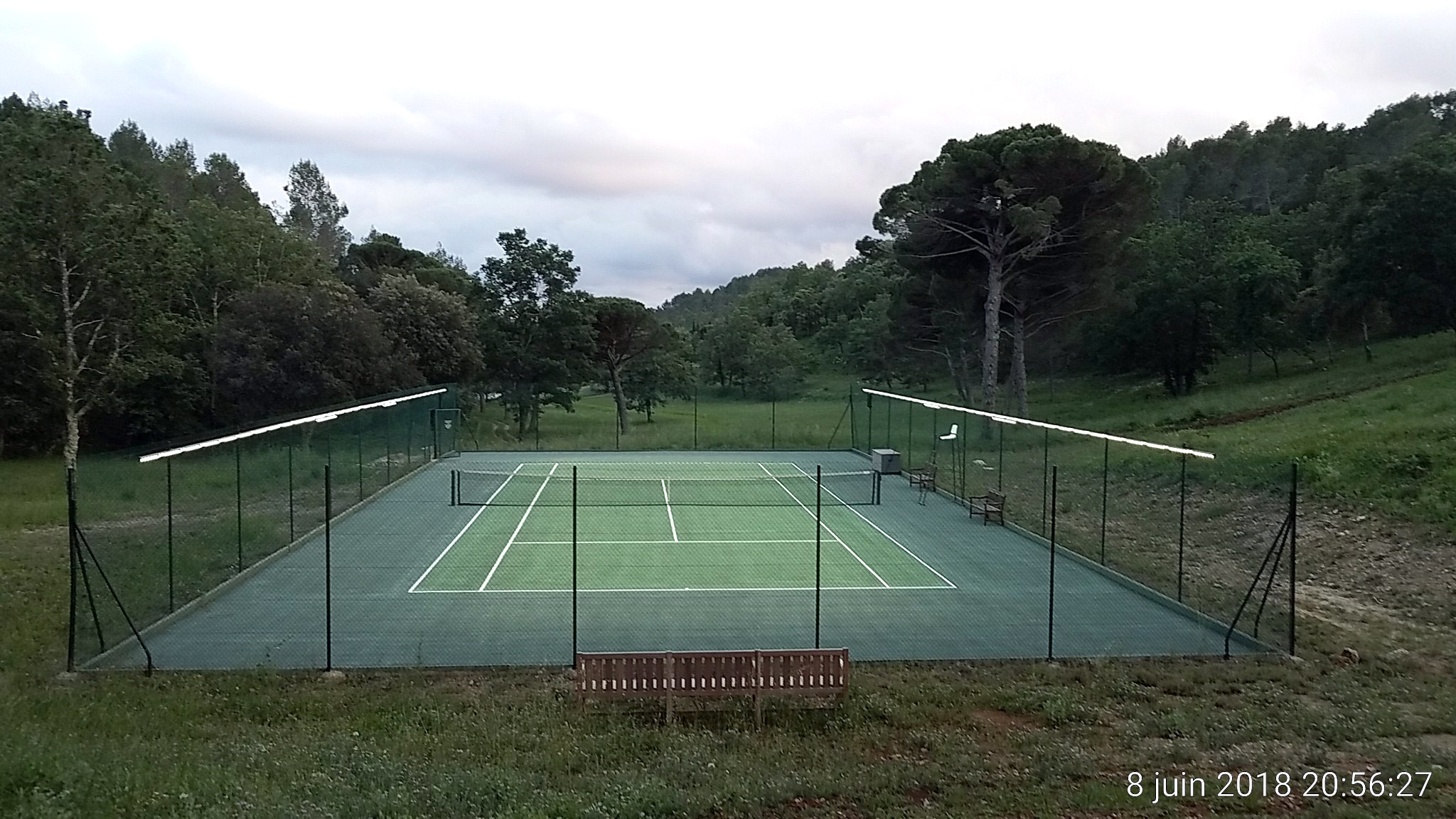 Tweener®'s revolutionary tennis court lighting integrates into your court's fencing with easy installation.