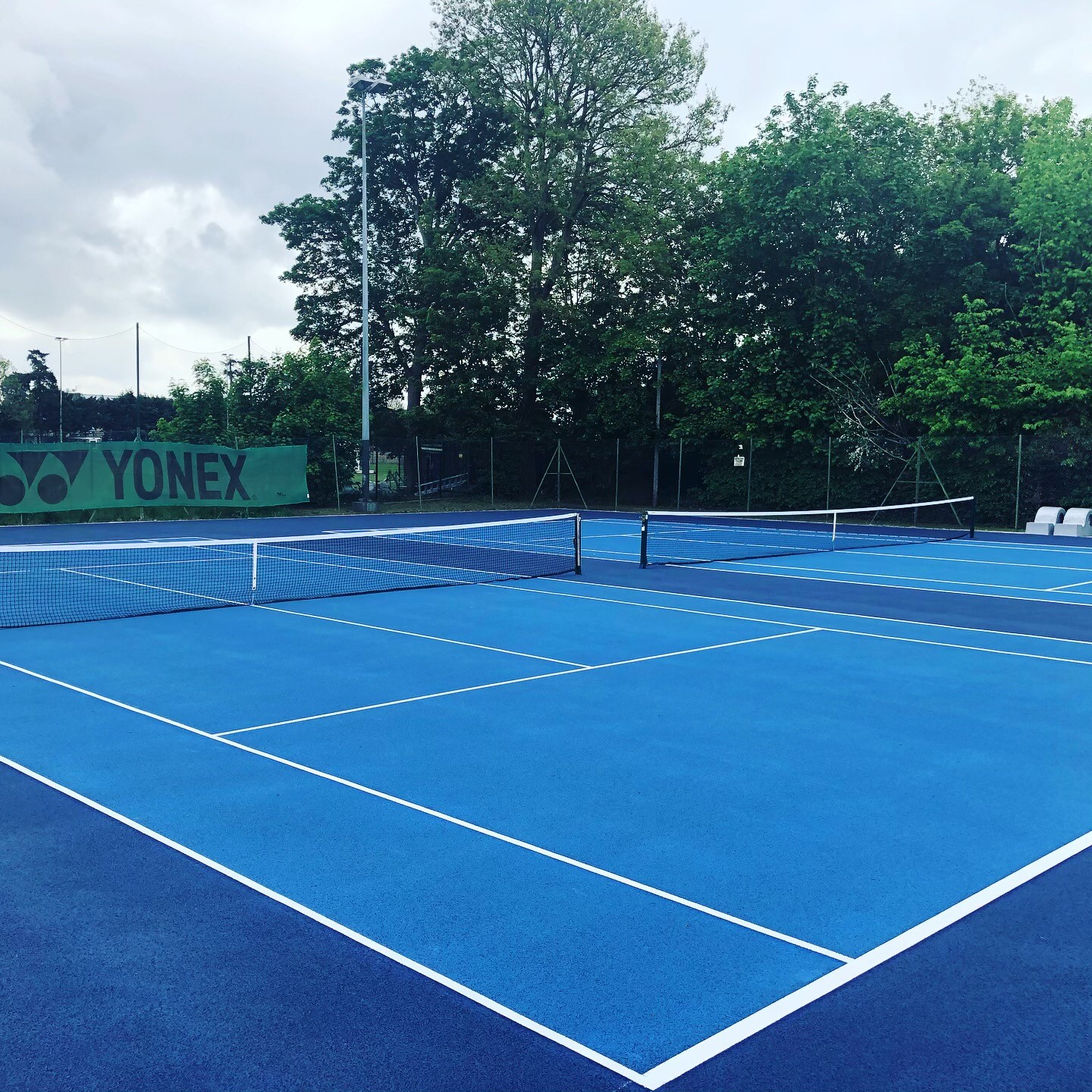 Asphalt tennis courts resurfacing at Hoddesdon Lawn Tennis Club in Hertfordshire