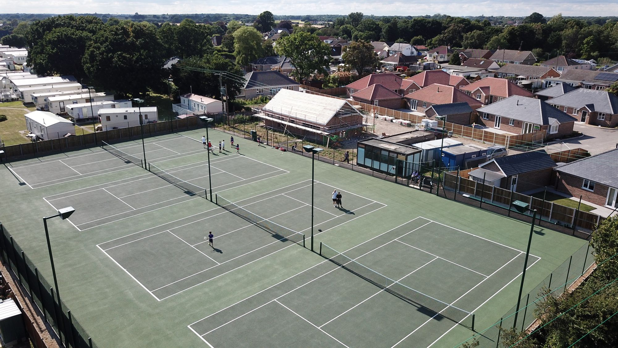Modern asphalt courts are an ideal option for clubs requiring minimal tennis court maintenance