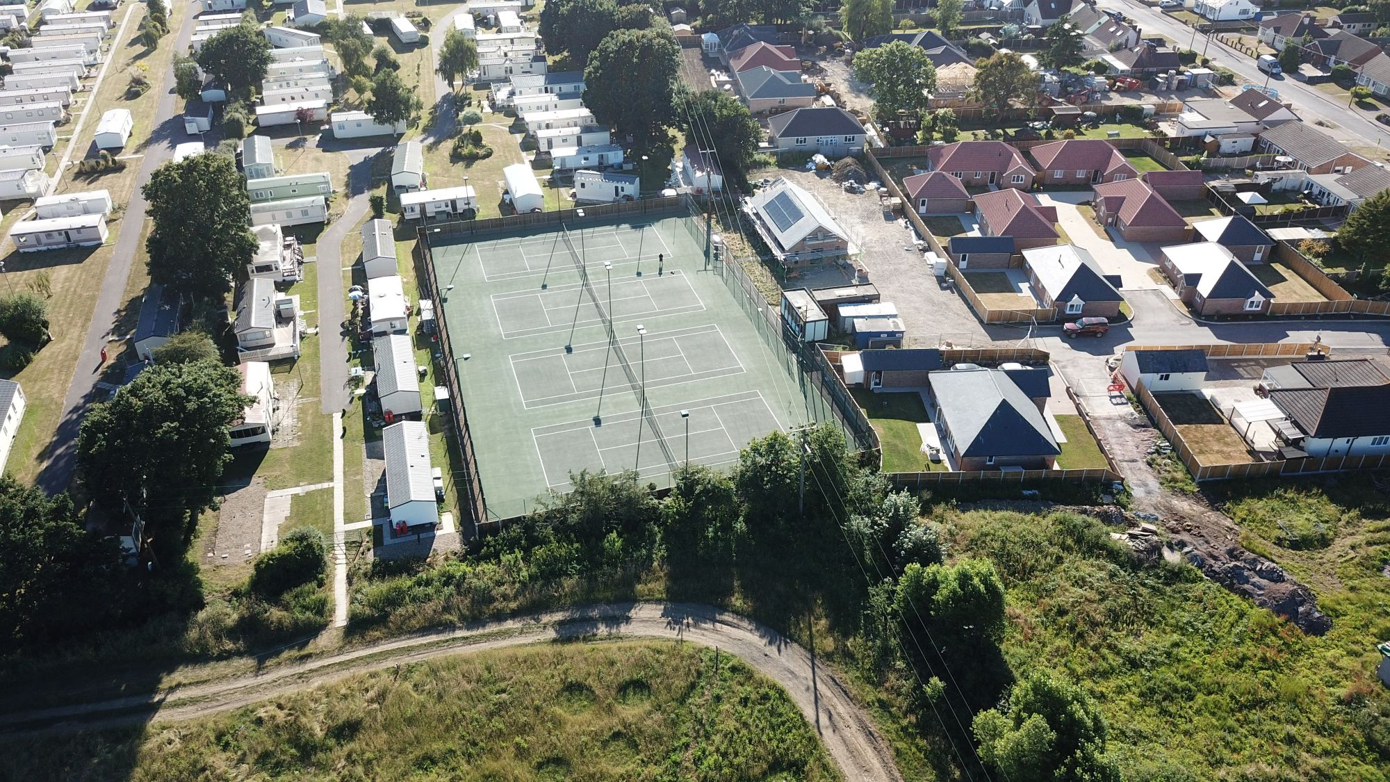 ETC Sports Surfaces are specialists in installing industry leading asphalt tennis courts in residential areas