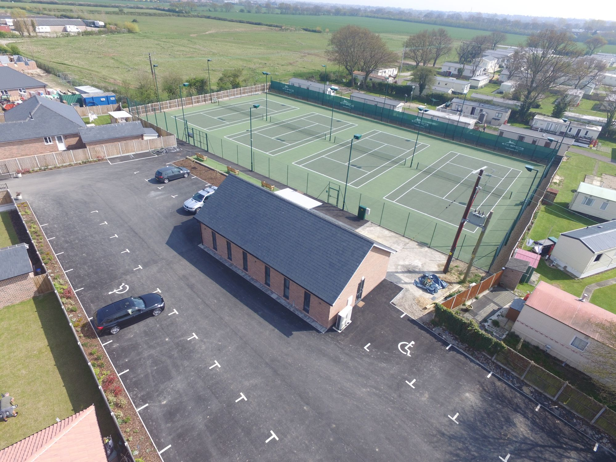 We constructed these asphalt tennis courts with full accessibility in mind for the convenience of members and residents.