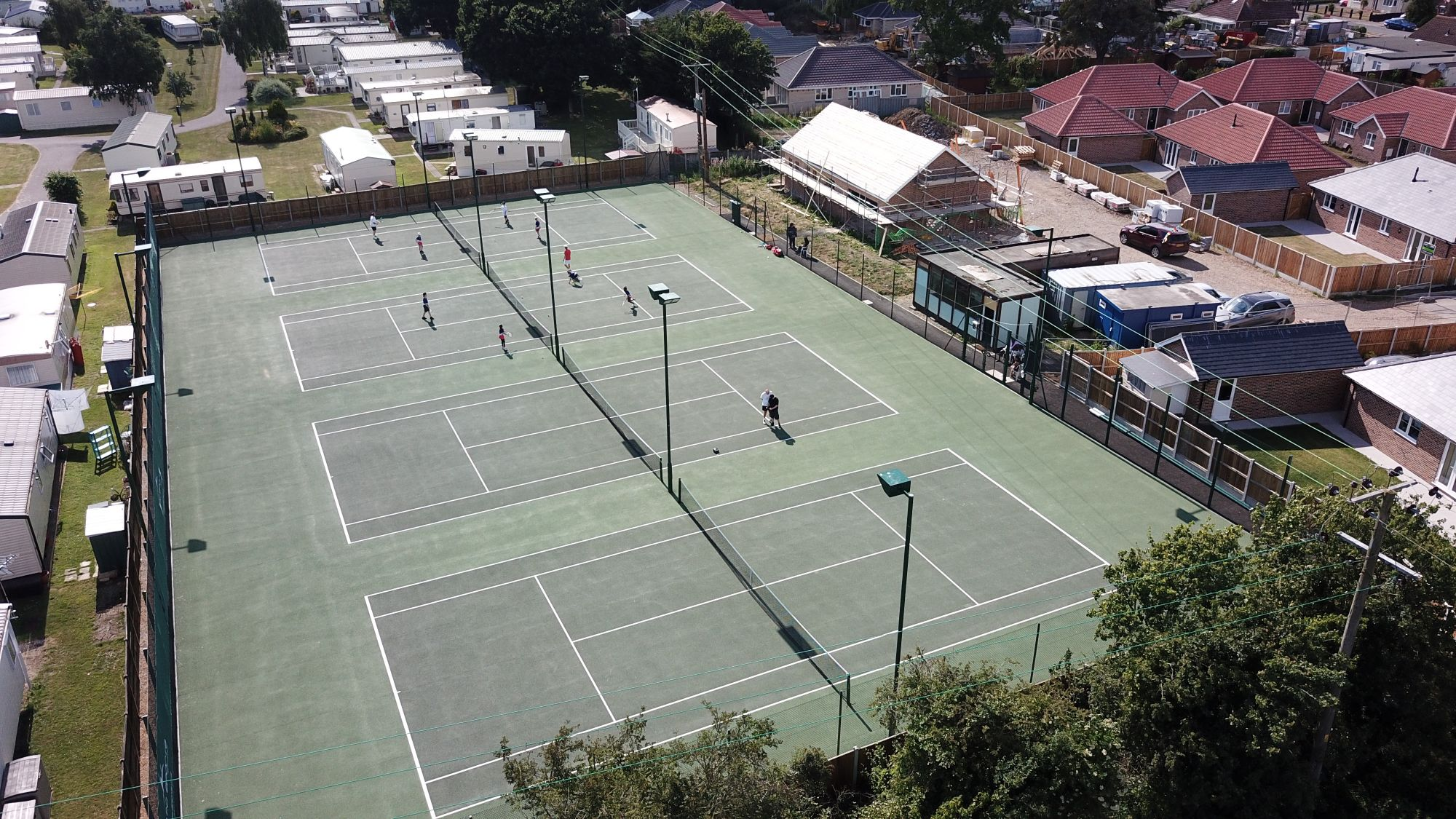 Little Clacton Tennis Club's new hard courts feature tennis court floodlights powered by renewable energy