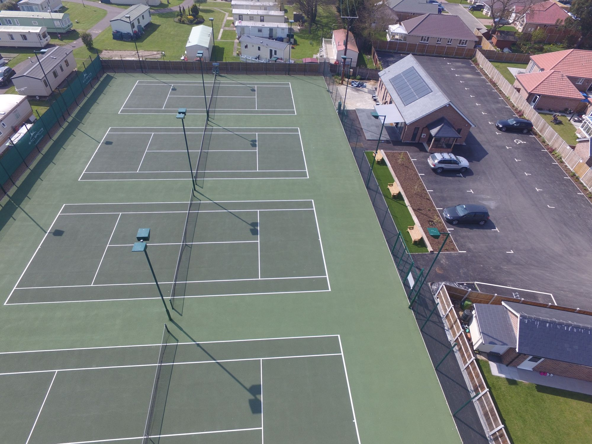 This major tennis club upgrade includes four new asphalt tennis courts plus access, floodlighting and finishing works