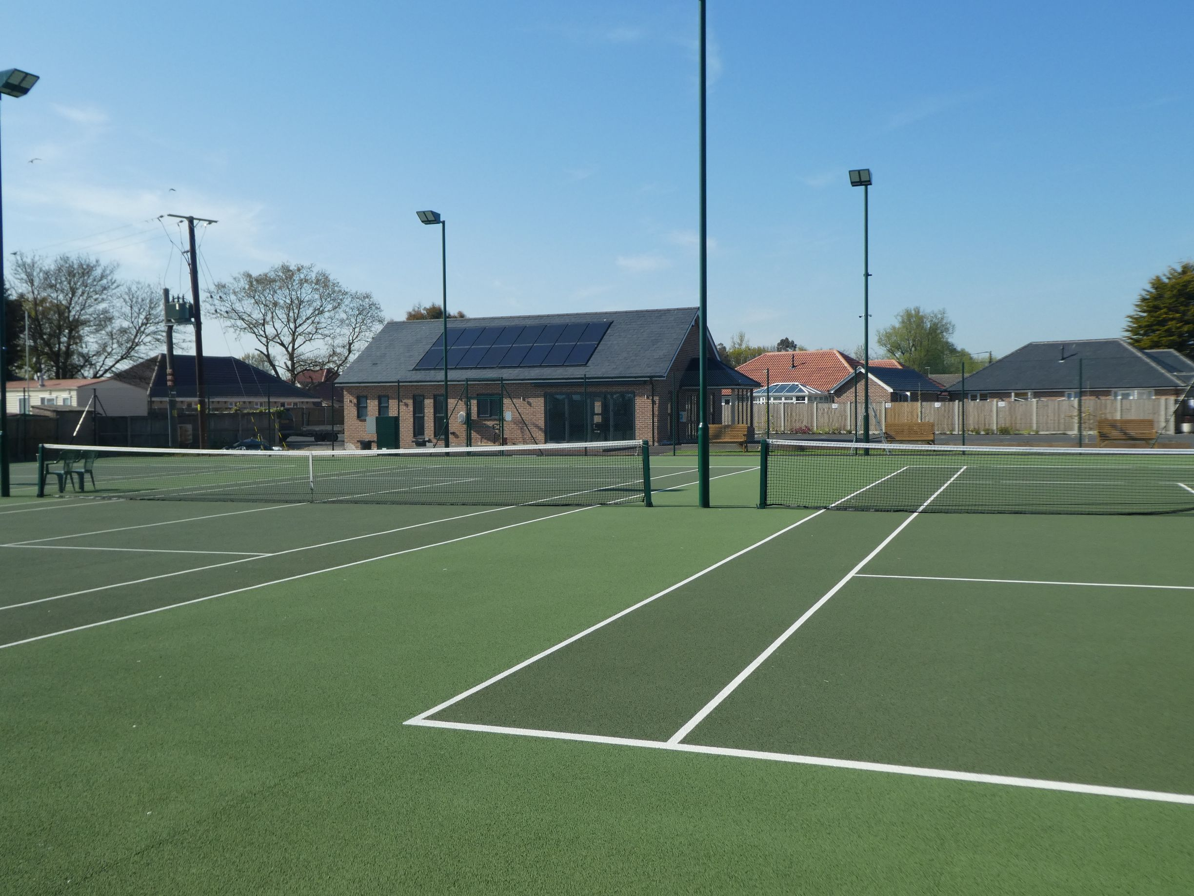 ETC Sports Surfaces delivered four full sized, asphalt tennis court surfaces plus all finishing equipment, including chainlink fencing, floodlighting and nets.