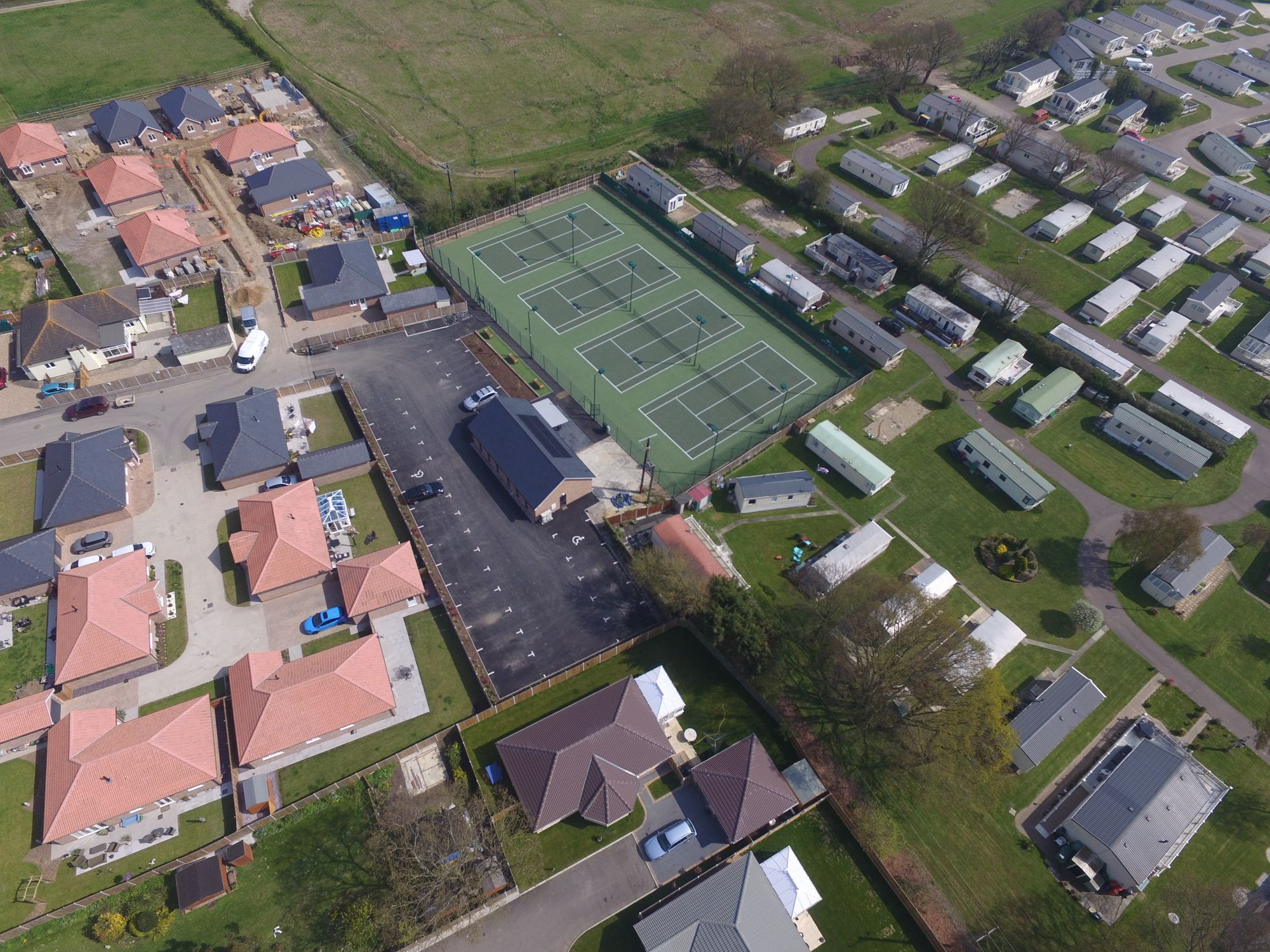 These tennis court surfaces with protective fencing were sensitively designed to sit comfortably within a popular residential area of Essex